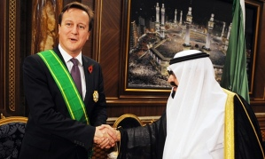 Our glorious Prime Minister, shaking hands with one of Britain's iron-fisted allies.